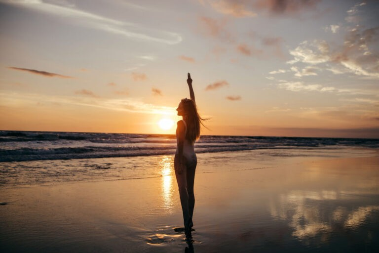 full-length-portrait-from-back-girl-looking-sea-sunset